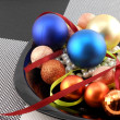 Decorative christmas ball and pearls on a plate, new year holiday — Stock Photo