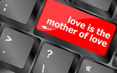 Computer keyboard with words love is the mother of love — Stock Photo