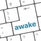 Awake word on keyboard key, notebook computer — Stock Photo