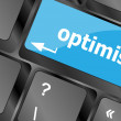 Stock Photo: Optimism button on the keyboard close-up