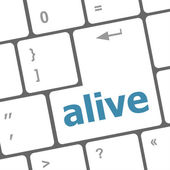 Alive text on laptop computer keyboard key button — Stock Photo