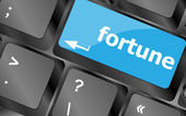 Fortune for investment concept with a orange button on computer keyboard — Stock Photo