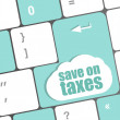 Stock Photo: Save on taxes word on laptop keyboard key, business concept