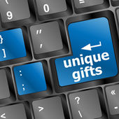 Unique gifts on the keyboard - holiday concept — Stock Photo