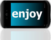 Web development concept: smartphone with word enjoy on display — Стоковое фото