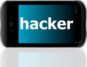Smartphone with word hacker on display, business concept — Stock Photo