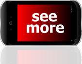 Smartphone con palabra ver más en pantalla, concepto de negocio — Foto de Stock