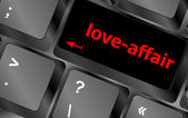 Love-affair on key or keyboard showing internet dating concept — Stok fotoğraf