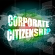 Stock Photo: Corporate citizenship words on digital screen with world map