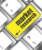 Key with market research text on laptop keyboard, business concept — Foto de Stock