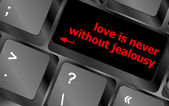 Button keypad keyboard key with love is never without jealousy words — Stock Photo
