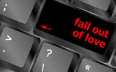 Modern keyboard key with words fall out in love — Stock Photo