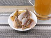 Smoked fish and cup of beer on a background — Foto Stock