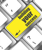 Building your success words on button or key showing motivation for job or business — Stock Photo