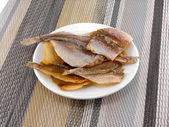 Delicious fish on white plate — Stock Photo