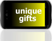 Digital smartphone with unique gifts words, holiday concept — Stock Photo