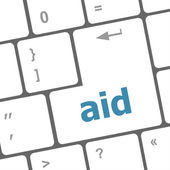 Aid word with key on enter keyboard — Stock Photo