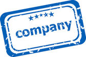Company on rubber stamp over a white background — Stock Photo