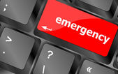Emergency word on keyboard key, notebook computer button — Stock Photo