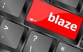 Blaze word on keyboard key, notebook computer button — Stock Photo