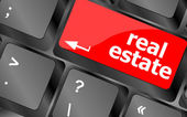 Real Estate concept. hot key on computer keyboard with Real Estate words — Stock Photo