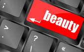 Geef toetsenbord sleutelknop naast met schoonheid woord op het — Stockfoto