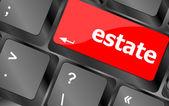 Palavra de imobiliário na chave, botão de computador notebook teclado — Foto Stock
