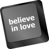 Keyboard key with believe in love text and arrow — Stock Photo