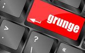 Teclado de la computadora con la palabra grunge en el botón enter, — Foto de Stock