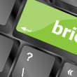 Brief text button on keyboard with soft focus — Stock Photo