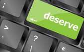 Deserve word on keyboard key, notebook computer button — Stock Photo