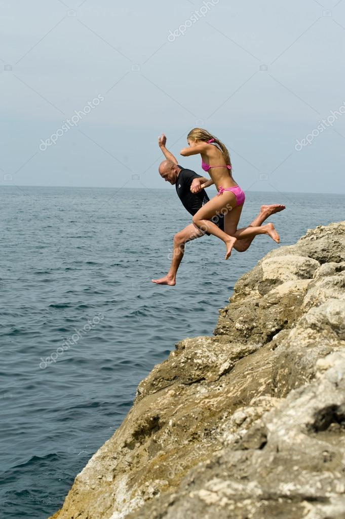 Jump off a cliff � Stock Photo � fotoluxstudio #12300833