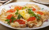 Pancakes with red caviar — Stock Photo