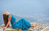 Girl in dress on the mountain — Stock Photo
