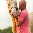 A man walks with his horse — Stock Photo #37588635