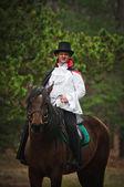 Men in costume on horseback — Stock Photo