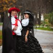 Man and woman in costume — Stock Photo