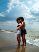 Man and woman at the sea — Stock Photo
