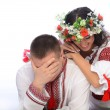 Man and woman in Ukrainian costumes — Stock Photo #41218827