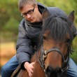 Young man on a horse — Stock Photo #42864689
