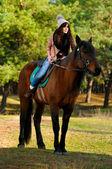 Woman on horse — Stock Photo