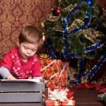 Boy prints letter to Santa on a typewriter — Stock Photo #11779846