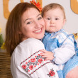 Family in Ukrainian national costumes — Stock Photo