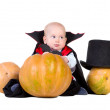 Baby boy in black halloween cloak with hat — Stock Photo