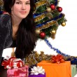 Woman near the Christmas tree — Stock Photo #16209209