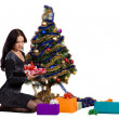 Woman near the Christmas tree — Stock Photo