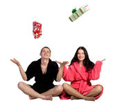 Young couple in robe — Stock Photo