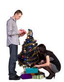 Men and women decorates the Christmas tree — Stock Photo