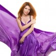 Red-haired girl in a purple dress — Stock Photo