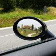 Farmhouse reflected in a rear-view mirror of a car — Stock Photo